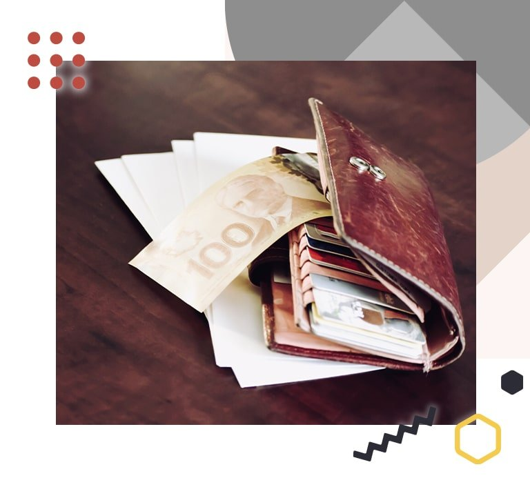 A photograph showing a wallet on a desk with a $100 note sticking out